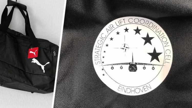 Die Sporttaschen Bedruckung des Strategic Airlift Coordination Cell